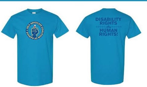 "SACK fist & butterfly logo in dark blue with pale yellow text on a blue-green colored t-shirt. Text on the back in dark blue reads ""Disability Rights are Human Rights"""